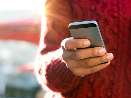 smartphone-hand-holding-getty-62-17-1_large.jpg