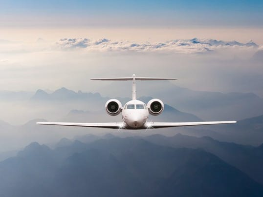 private-jet-in-sky_large.jpg