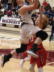 Tularosa's Shacie Marr glides toward the basket during a layup attempt.