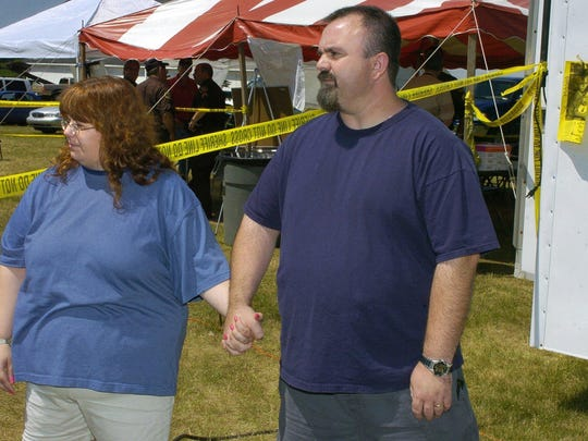 Lisa and Tim Holland visit at the command center in Williamston on July 7, 2005 as volunteers and law enforcement officials search for their missing 7-year-old son, Ricky. They later would be convicted of his murder.