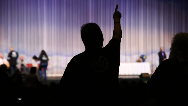 """Westgate employee Chris Bender dances along to music on Wednesday, Dec. 14, 2016, in Smokey Mountain Opry Theater at the """"Honor our Heroes"""" event. The event celebrates the many first responders and employees who helped evacuate guests, as well as the speedy re-opening of the resort."""