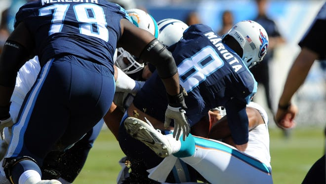 Oct 18, 2015; Nashville, TN, USA; Tennessee Titans quarterback Marcus Mariota (8) is sacked during the first half against the Miami Dolphins at Nissan Stadium. Mandatory Credit: Christopher Hanewinckel-USA TODAY Sports