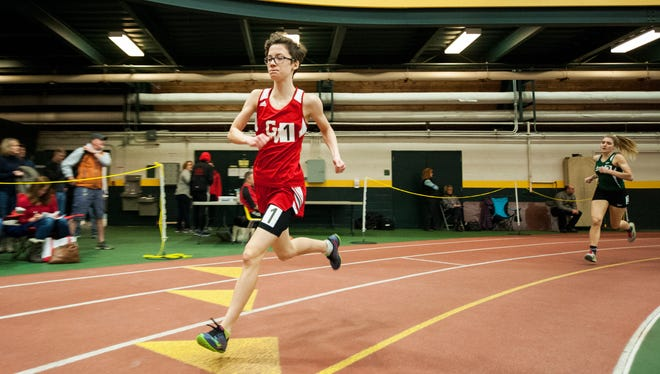 CVU's Alice Larson competes in the girls 1,500m race during the high school indoor track and field championships at Gutterson Field House on Saturday February 10, 2018 in Burlington.