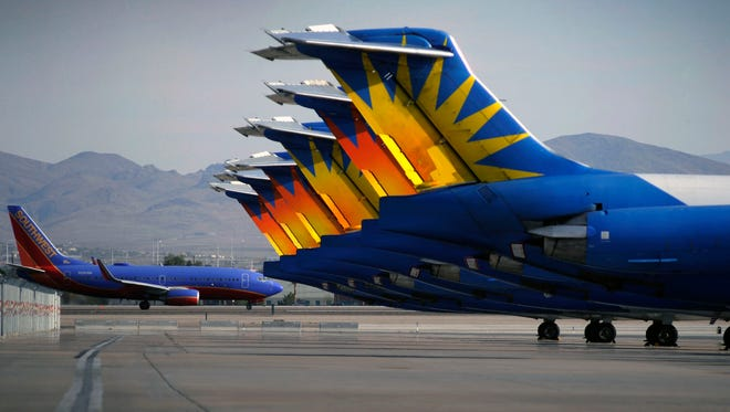A Southwest 737 taxis beyond the tails of Allegiant Air jets at McCarran International Airport in Las Vegas on May 9, 2013.