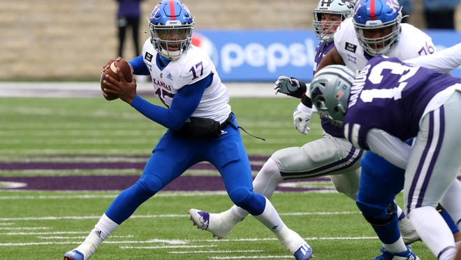 Kansas quarterback Jalon Daniels, left, was 22-for-39 passing for 207 yards and an interception and added two rushing touchdowns in the Jayhawks' 55-14 defeat last Saturday at then-No. 20 Kansas State.