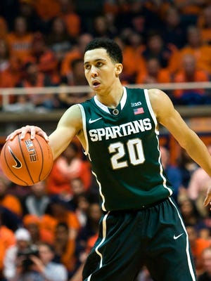 Michigan State Spartans guard Travis Trice (20) brings the ball up the court against the Illinois Fighting Illini at State Farm Center. Michigan State beat Illinois 60 to 53.