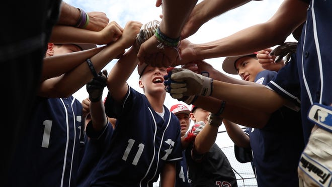"""Robbie Wing leads the team in a cheer of """"mission regionals"""" before the start of practice.  Penfield Natinoal Little League All-Stars is heading to the Bronx to try and become state champions."""
