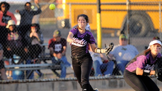 Wylie third baseman Keetyn Davis (5) throws to first base for an out during the Lady Bulldogs' 4-3 loss to Vernon in Game 2 of the bi-district playoffs at Cates Field in Snyder on Friday, April 27, 2018.