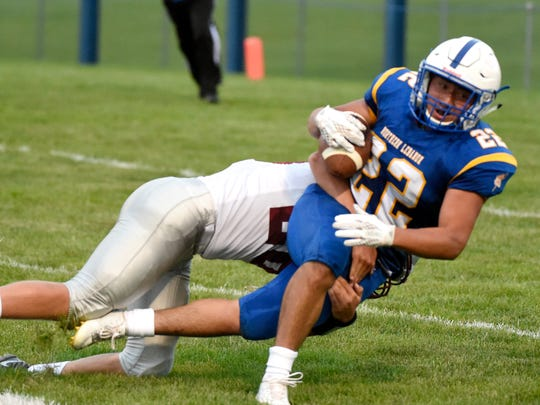 Viking Luis Negreiros is tackled during the first quarter of play against Pine Grove. The Northern Lebanon Viking football team opened their 2017 season against Pine Grove Area High School Friday, Aug. 25 at home. The Viking Marching Band took the field before the game to perform and area youth cheerleaders and football players were recognized before kick off.