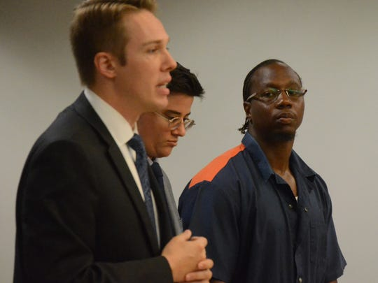 Assistant Calhoun County Prosecutor Chris Baldwin speaks as Joseph Stanford Jr., right, and his attorney, Sophia Nelson, listen.