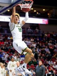 Seybian Sims of Iowa City West dunks the ball during