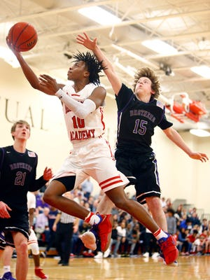 Brentwood Academy's Darius Garland (10) shoots past Christian Brothers' Spencer Stalker (15) during their Division II-AA state quarterfinal game Saturday. Brentwood Academy won 63-58