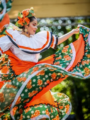 A member of the Ballet Folklórico México en la Piel Academia performing at the fourth annual Noche Cultural at Island Park in Springfield last year. [Dana Sparks/The Register-Guard] - registerguard.com