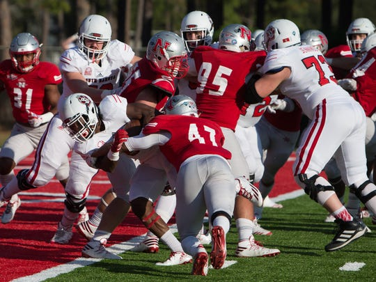 Michael Frederick pushes through the Nicholls defense for a touchdown.