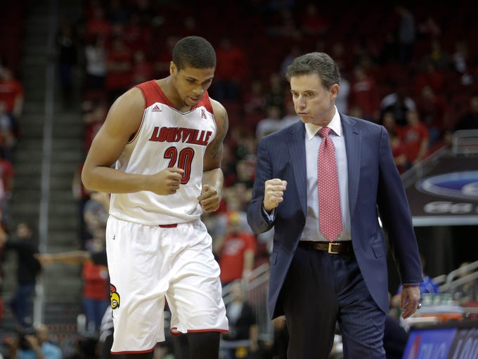 Louisville coach Rick Pitino urges on Wayne Blackshear  in lst half play. December 4, 2013