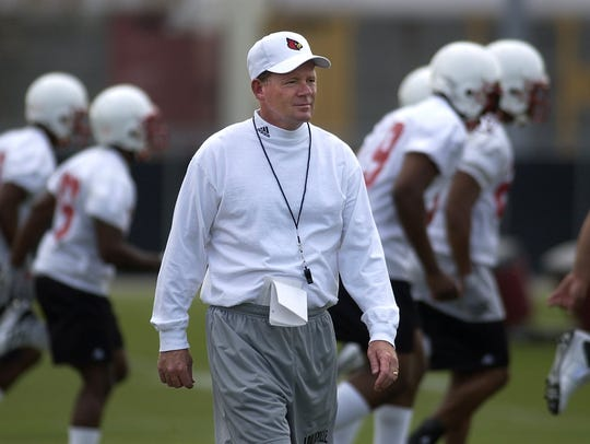 Bobby Petrino, shown with Louisville's team in 2003,