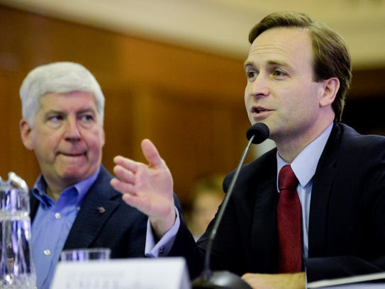 Gov. Rick Snyder listens as Lt. Gov. Brian Calley talks about the fiscal 2018 and 2019 budget recommendations on Feb. 8, 2017. Calley has been Snyder's  lieutenant governor since 2011.