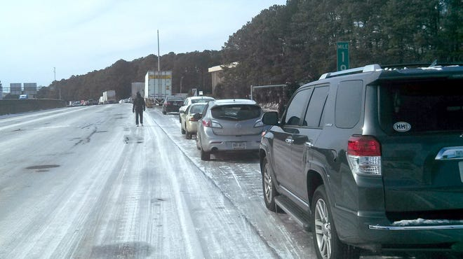 Corey Smith took this photo Wednesday morning from his car, where he'd spent the night, of motorists stranded on Interstate 285 in Georgia.