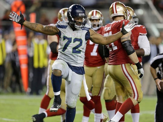 FILE - In this Oct. 22, 2015, file photo, Seattle Seahawks defensive end Michael Bennett (72) reacts after sacking San Francisco 49ers quarterback Colin Kaepernick during the second half of an NFL football game in Santa Clara, Calif. The Super Bowl champion Philadelphia Eagles have acquired three-time Pro Bowl defensive end Michael Bennett from the Seattle Seahawks, two people familiar with the trade told The Associated Press Wednesday, March 7, 2018. (AP Photo/Ben Margot, File)