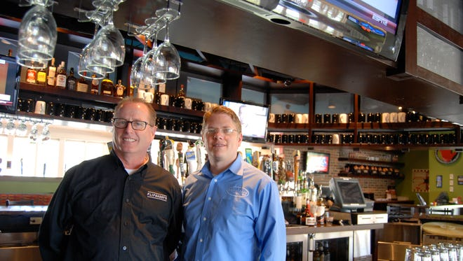 Bob Dames and Ed Biery will open a new Flipdaddy's Burgers and Beers location in Union this summer. Here, they're pictured in the restaurant's Symmes Twp. location.