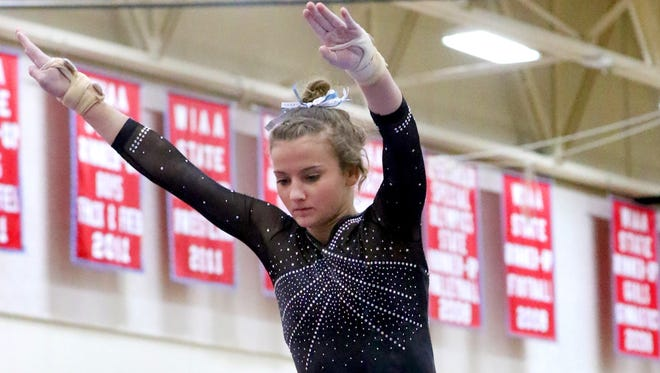 Franklin/Oak Creek/Whitnall/Muskego's Krystal Nelson competes on beam during a quad meet at Arrowhead on Feb. 1.