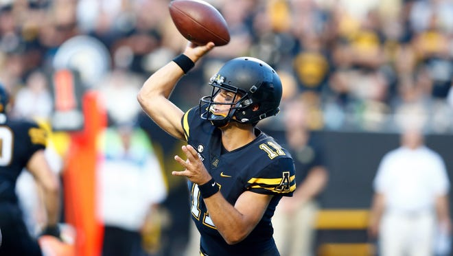Appalachian State Mountaineers quarterback Taylor Lamb (11) passes the ball during the fourth quarter against the Wake Forest Demon Deacons at Kidd Brewer Stadium.