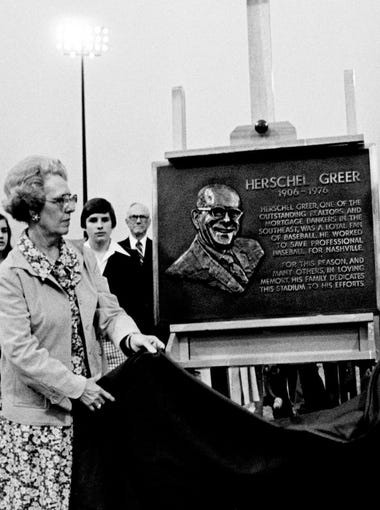 Mrs. Herschel Greer, left, and daughter unveil a plaque dedicating the Nashville Sounds baseball stadium to the late Herschel Greer May 18, 1978. The dedication took place prior to the game.