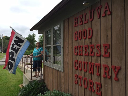 Julie Schuldt shops one last time at the Heluva Good! Cheese Country Store in Sodus, Wayne County on Wednesday, June 24. The store and a nearby packaging plant were slated to close Friday, June 26, putting 59 people out of work. Heluva Good! has been a fixture in Sodus since 1925.