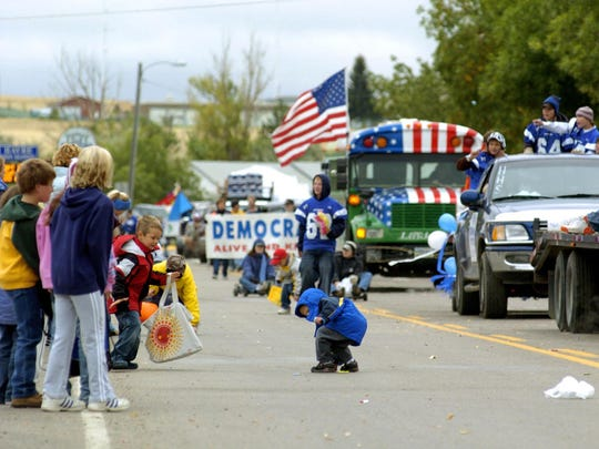 Children dash for the candy during the Havre Festival Days annual parade.