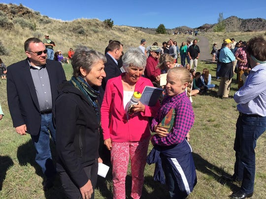 Interior Secretary Sally Jewell, left, speaks to Ruby Jennings, a sixth-grader and granddaughter of Gerry Jennings of Great Falls, center.