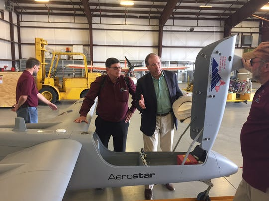 "Dennis ""Zak"" Zaklan, deputy director of New Mexico State University's Unmanned Aircraft Systems Flight Test Facility, shows off the Aerostar B drone to Sen. Tom Udall, D-Santa Fe, during the senator's visit to the facility on Tuesday, Nov. 1, 2016."