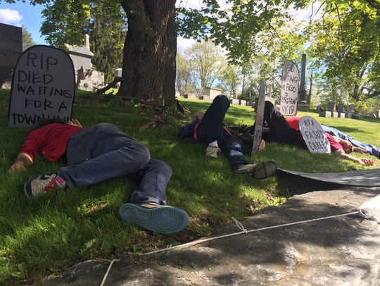 """Demonstrators participate in a """"die-in"""" at a protest"""
