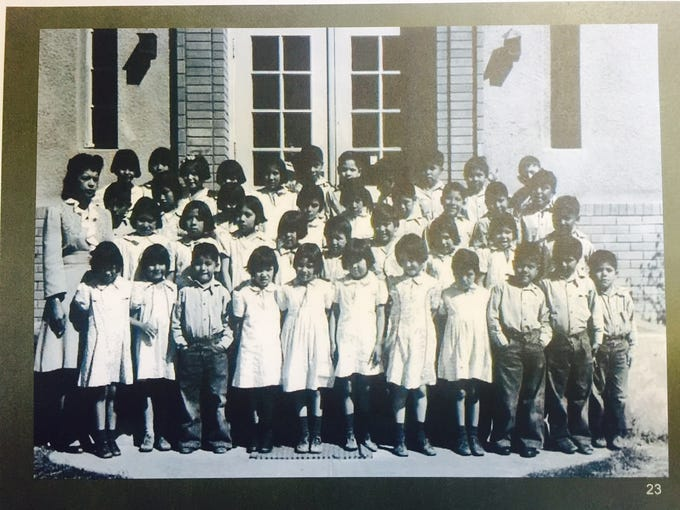 Native American children in front of the elementary