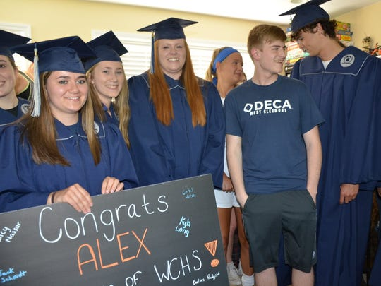 West Clermont High School seniors take a graduation celebration to the home of their classmate Alex Click who was unable to attend senior awards or graduation.