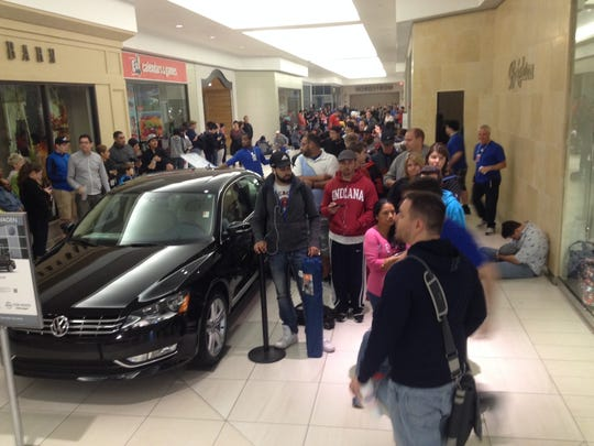 Shoppers arrived early to the Fashion Mall at Keystone to buy the iPhone 6 at the Apple Store. That was the last version of the iPhone to attract long lines on its release date.