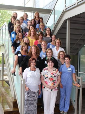 Members of the Cancer Rehab Team at the Adena Cancer Center pose for a photo at the center.