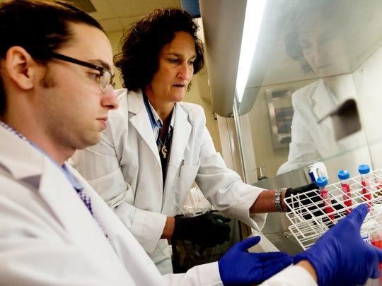 CBC lead biologist Maria Escalona helps LSU graduate
