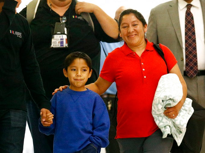 Darwin Micheal Mejia, 7, and his mother, Beata Mariana