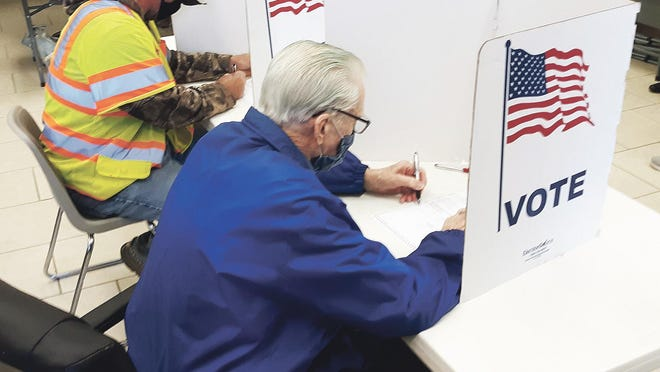 """Voters cast their general election ballots Tuesday morning at Fire Station No. 1 in Lansing. Michael Wiederholt, a Lansing resident, said the voting lines were """"short and moving fast."""""""