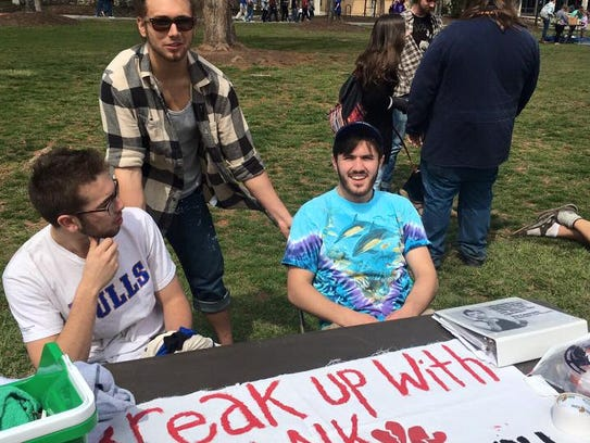 Members of student group UNCA Divest, from left, James