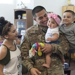 Army Sgt. surprises wife and son, holds daughter for the first time