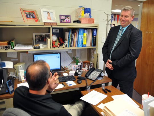 Cumberland Christian School headmaster Ken Howard, of Vineland, talks with high school assistant principal Mark Gebhardt, of Millville (from right), Wednesday, Aug. 10, 2016 in Vineland.