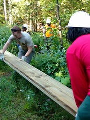 This photo from the Michigan Department of Natural Resources shows teens from Detroit working on a boardwalk in Marquette County.