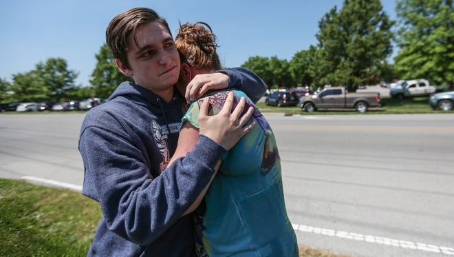 Sophomore Austin Duncan hugs his mom, Tina, near Noblesville High School on Friday, May 25, 208.
