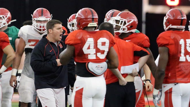 Coach Chris Ash (black top) will get to evaluate Rutgers football players in a scrimmage setting for the first time.