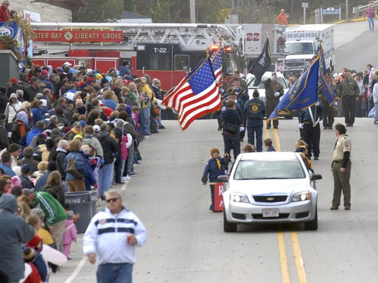 A massive Fall Fest crowd watching its annual parade along State 42 in Sister Bay.