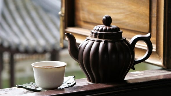 Enjoy the fall foliage and sip tea in the tranquil setting at Portland's Lan Su Chinese Garden on Fridays, Saturdays, Sundays and Mondays in October.