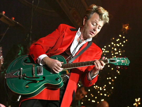 Brian Setzer performs a Christmas show with the Brian Setzer Orchestra in this file photo.