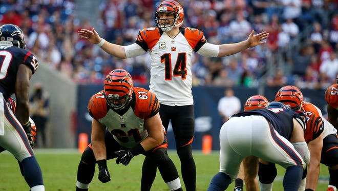 Bengals quarterback Andy Dalton gets his line ready during the fourth quarter against the Texans on Sunday.