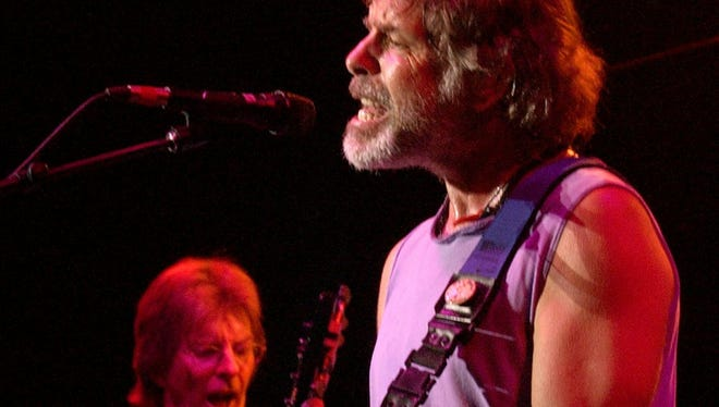 Bob Weir, right, and Phil Lesh, left, perform with The Other Ones at Alpine Valley Music Theatre in East Troy on Sunday, Aug. 4, 2002, at the Terrapin Station Grateful Dead Reunion. It was the first time the Grateful Dead's original band members, Weir, Lesh, Mickey Hart, and Bill Kreutzmann, had joined forces for a major concert since the death of band founder and lead singer Jerry Garcia in 1995.
